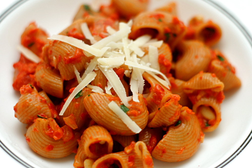 Add the sauce to the cooked pasta, and stir over medium-high heat ...